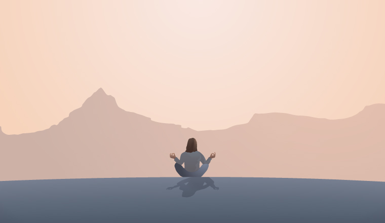 A woman meditated in from on some distant mountains