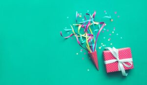 Party backgrounds with colorful confetti, streamers and gift box.