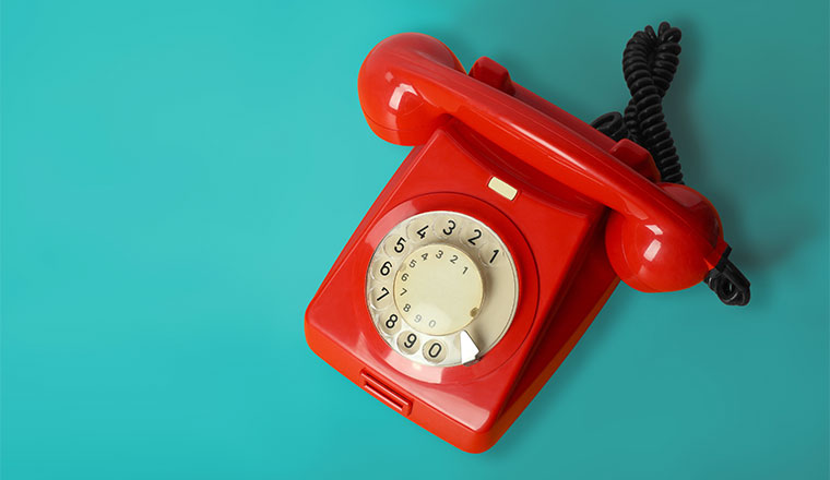 Beautiful red vintage phone on a blue background