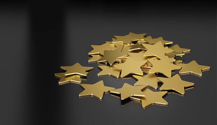 3D illustration of many golden stars over black background,