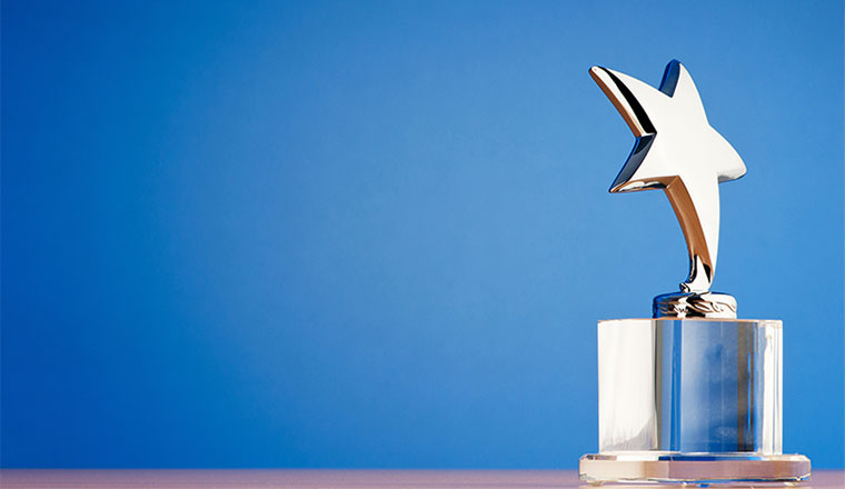 A photo of a star award against a gradient background