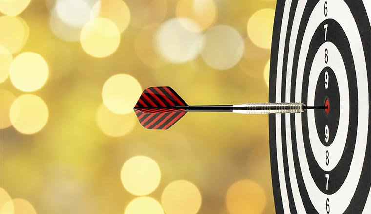 close up dart arrow hitting on target center on bullseye in dart