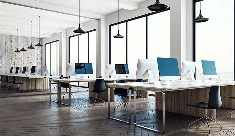 Minimalistic coworking office interior with equipment, furniture, city view and daylight.