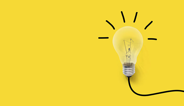 A picture of a light bulb on yellow background
