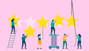 A picture of people working together to construct a five star sign