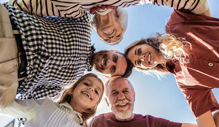 A photo of a huddle between people of different generations