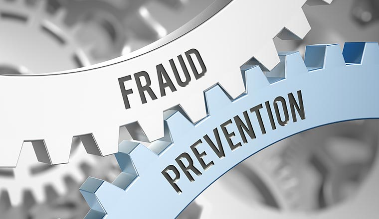 "A picture of two cogs, one labelled ""fraud"" and the other ""prevention"""