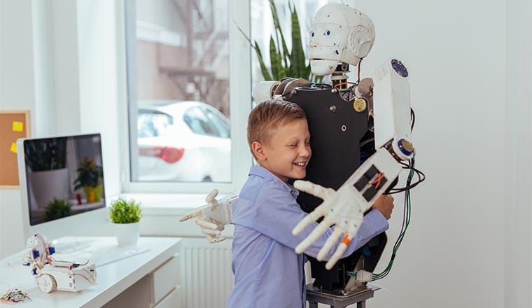 A photo of a boy hugging a robot