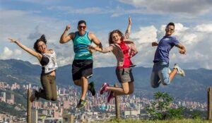A photo of four people happily jumping