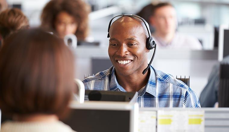 A photo of a smiling contact centre advisor