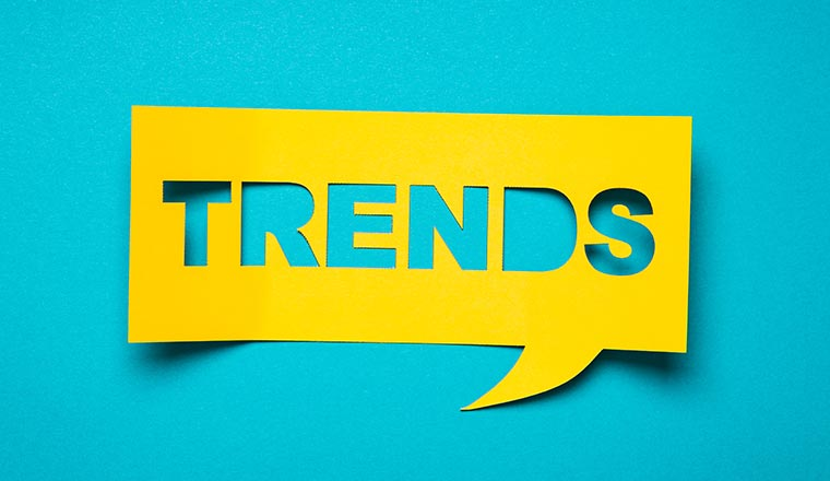 """A photo of a square speech bubble with the word """"trends"""""""