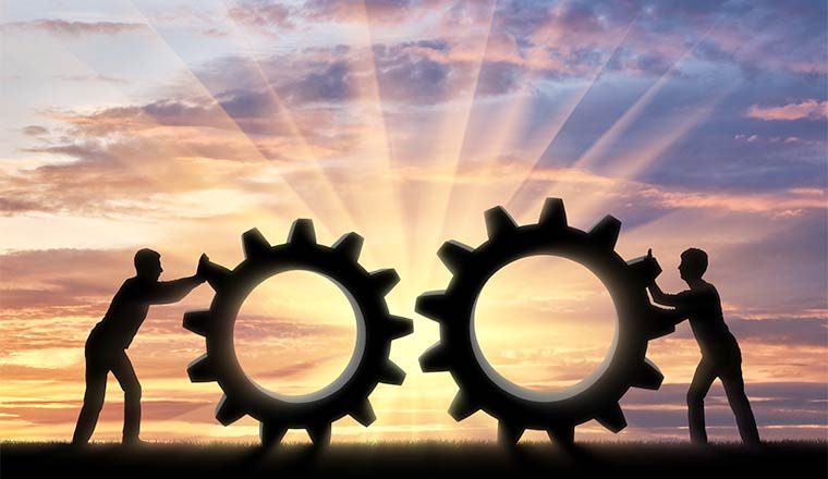 A picture of two people with cogs