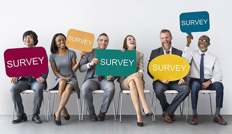 people sat down with survey signs
