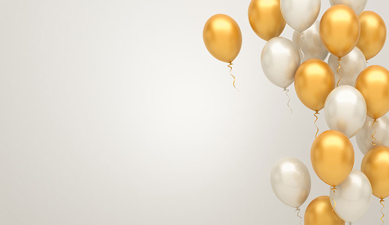A picture of gold and silver balloons