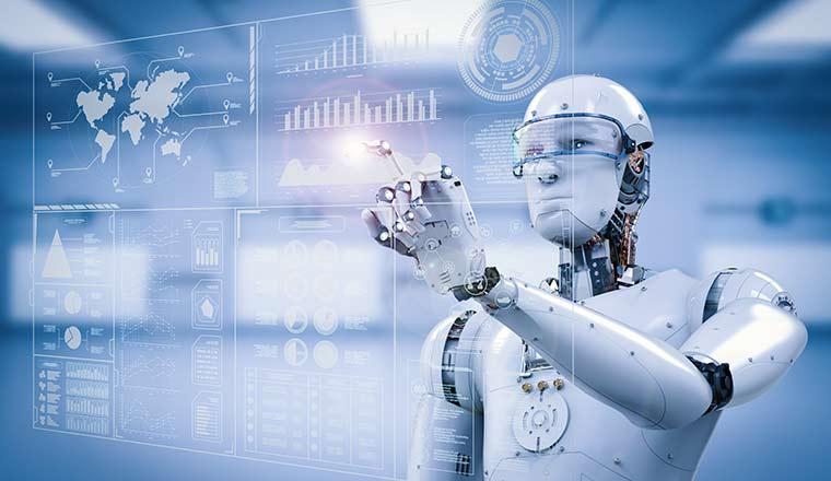 An artificial robot points to a digital screen