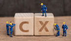 """A picture of wooden blocks spelling out """"CX"""""""