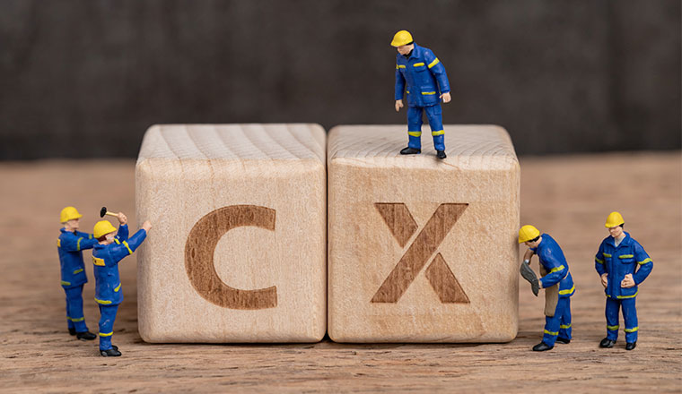 "A picture of wooden blocks spelling out ""CX"""
