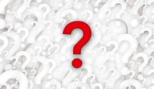 A red question mark is in front of many white question marks