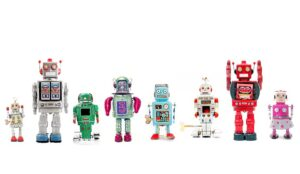 A group of toy robots in a row