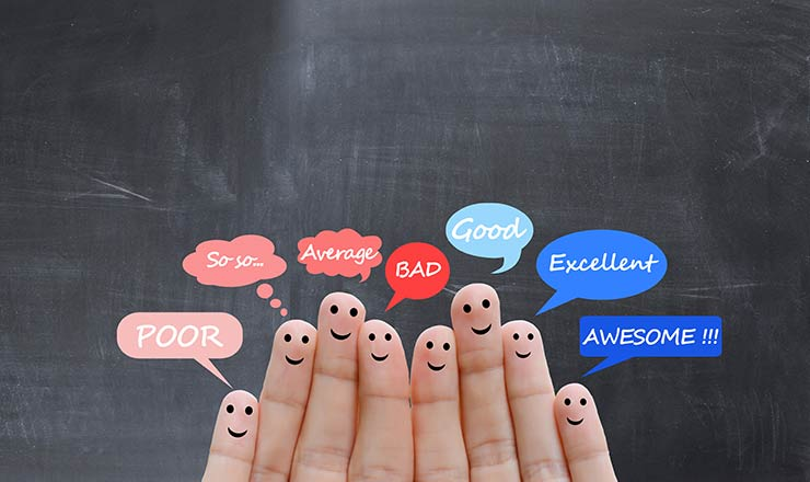 Finger tips have smiley faces and 'poor', 'so-so', 'average', 'BAD', 'good', 'excellent' and 'awesome'