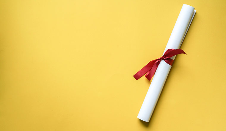 A photo of a certificate scroll with a ribbon