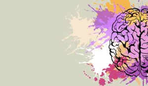 A photo of paint splashes on a drawing of a human brain