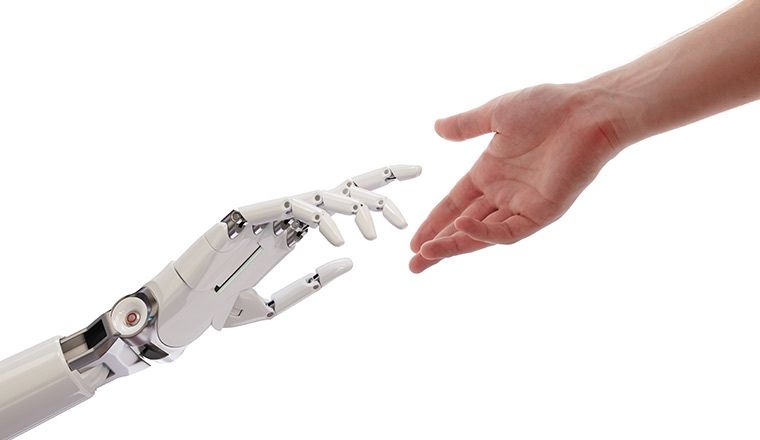 A picture of a persons hand and a robot hand