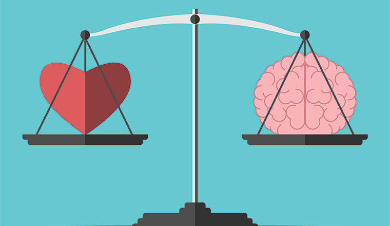 A picture of a heart and a brain on a weighing scales
