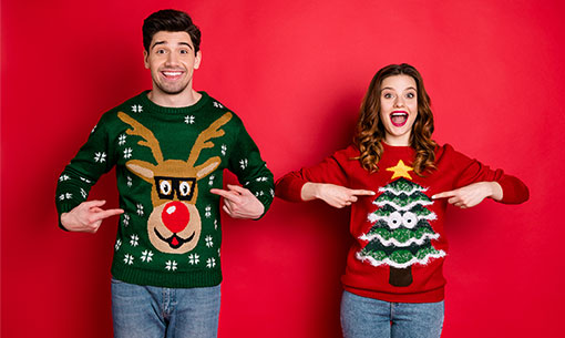 A photo of people wearing ugly Christmas jumper