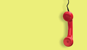 A photo of an old, red phone
