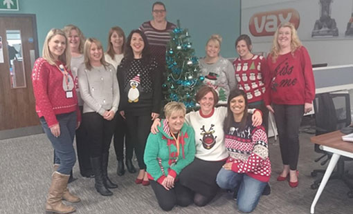 A photo of the Vax contact centre team celebrating Christmas