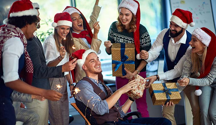 A photo of an office team having fun a Christmas