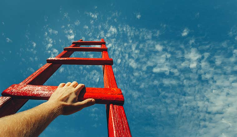 A picture of a ladder facing up to the sky