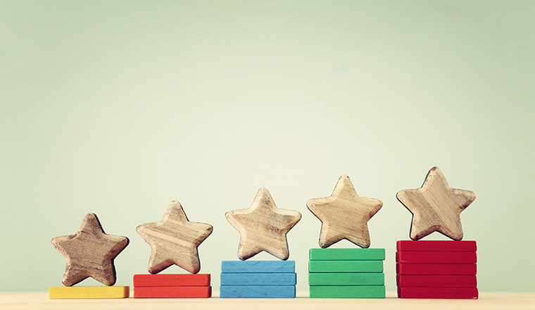 A picture of 5 wooden stars on wooden blocks that increase in height from 1 to 5