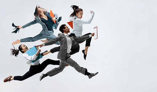 A photo of business people making energetic poses