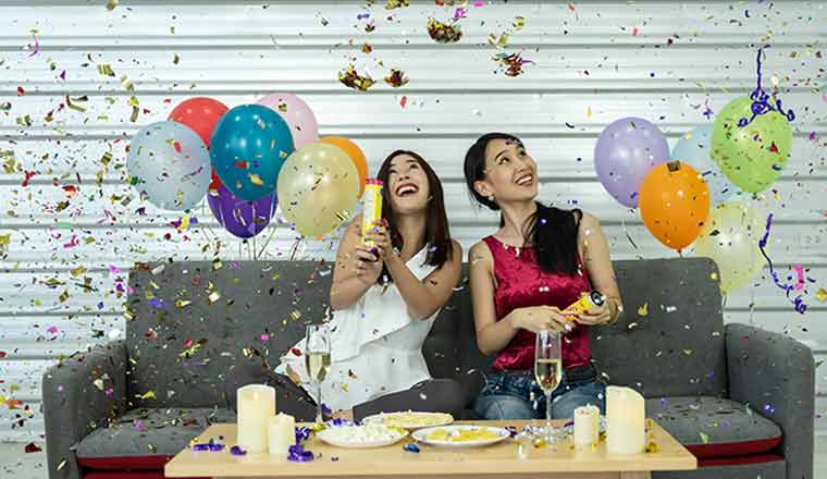 A picture of two females celebrating at a party
