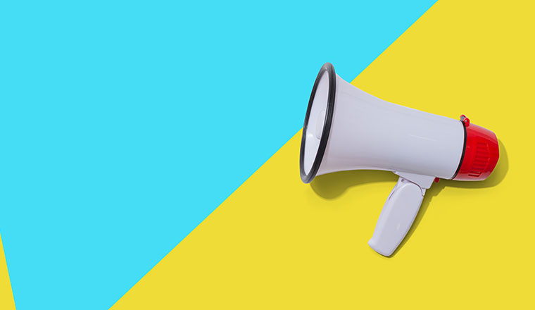 A photo of a megaphone on a blue and yellow background