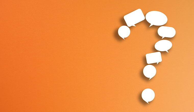 A picture of a question mark made from speech bubbles