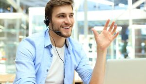 A photo of smiling contact centre advisor making a point