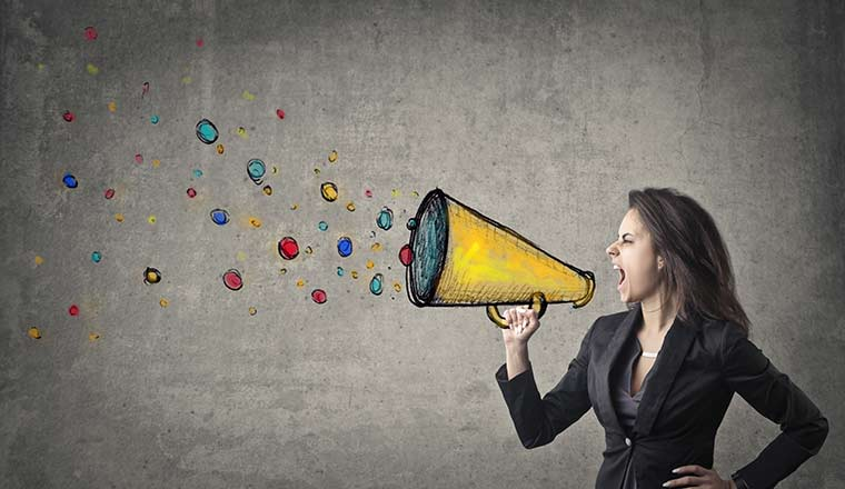 A picture of a woman shouting down a megaphone
