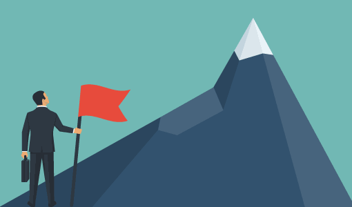 A picture of a person with a flag looking up at a mountain