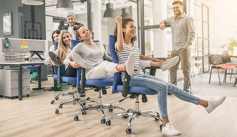 A photo of people playing office chair conga