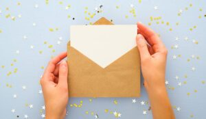A photo of an envelope being opened with confetti