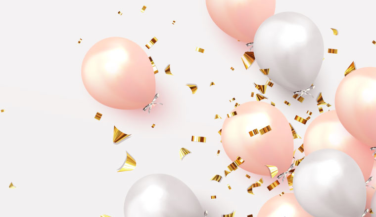 A pictiure of pink and white balloons, with golden confetti