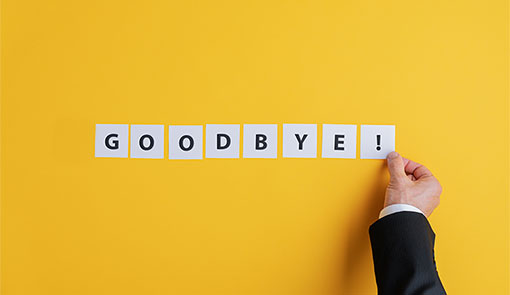 A picture of a person spelling out goodbye