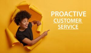 """A picture of someone pointing to the words """"proactive customer service"""""""