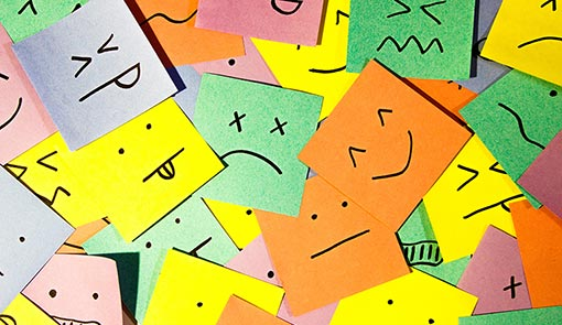 A photo of post it notes that summarize emotions