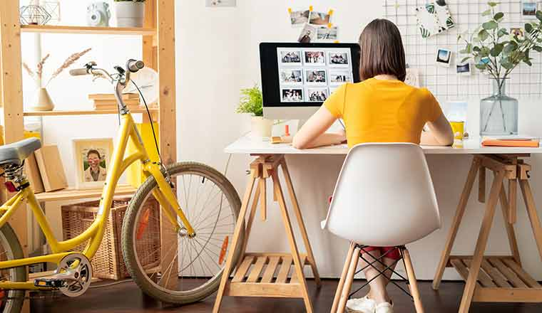 A picture of a person working in home office