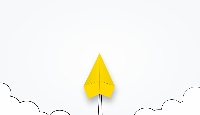 A picture of a paper airplane launchng to the sky