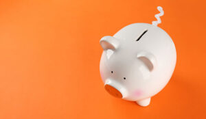A picture of a piggy bank on an orange background